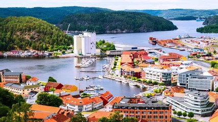 Wall Mural - Halden, Norway. Aerial view of the houses and yachts in port of Halden, Norway. Time-lapse during the cloudy day in summer