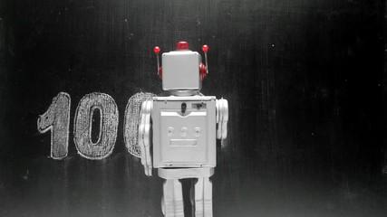 Wall Mural - retro robot writes binary code on a blackboard