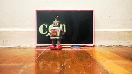 Fototapete - little robot writes CODING on a blackboard
