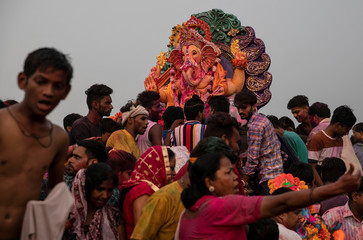 Devotees carry an idol of the Hindu god Ganesh, the deity of prosperity, for immersion in a temporary pond on the last day of the Ganesh Chaturthi festival in New Delhi