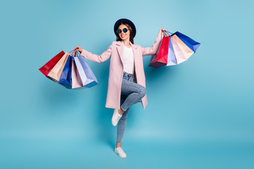 Full body photo of dancing rejoicing girl go shopping buy bargains wear retro pink vintage stylish outfit denim jeans eyewear eyeglasses isolated over blue background