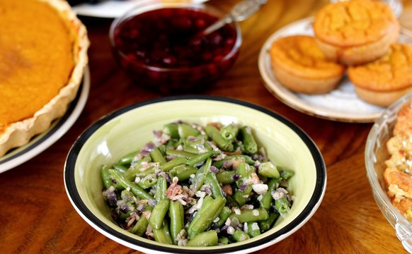 green beans with bacon and garlic. a traditional dish for Thanksgiving. refreshments on the festive table. celebration of the harvest day
