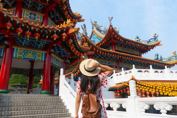 A woman tourist is sightseeing and traveling into Thean Hou Temple in Kuala Lumpur, Malaysia.
