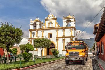 Chicken bus in front of Ermita de Santa Lucia, Antigua Guatemala, Guatemala