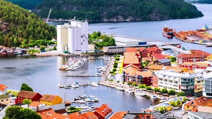 Wall Mural - Halden, Norway. Aerial view of the houses and yachts in port of Halden, Norway. Time-lapse during the cloudy day in summer, panning video