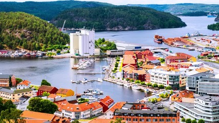 Wall Mural - Halden, Norway. Aerial view of the houses and yachts in port of Halden, Norway. Time-lapse during the cloudy day in summer, zoom in