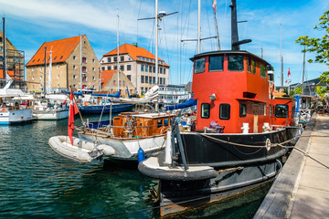 Christianshavn channel with colorful buildings and boats in Copenhagen, Denmark Fototapete