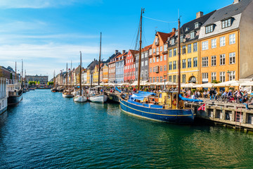 In de dag Schip View of Nyhavn pier with color buildings, ships, yachts and other boats in the Old Town of Copenhagen, Denmark