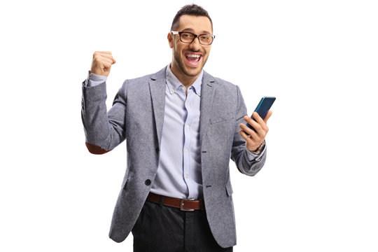 Happy man holding a mobile phone and gesturing yeah
