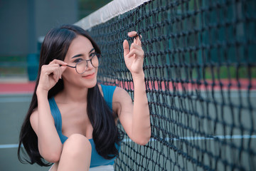 Portrait of asian woman at the tennis court,Thailand people take a picture