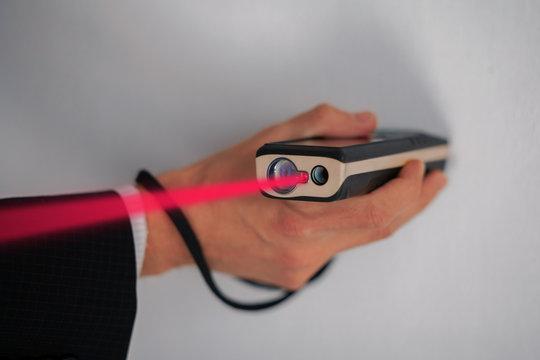 Laser rangefinder. Measurement of the area of the room with a laser range finder.