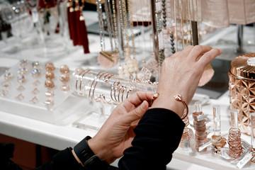 Lady trying on a bracelet
