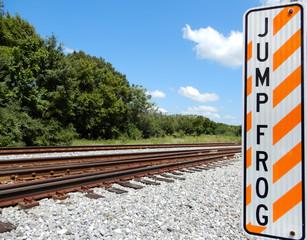 Jump frog sign near tracks