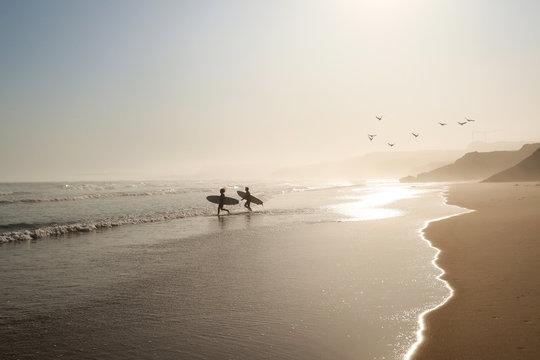 View to Surfer beach Praia do Lagido and island Baleal in summer, Peniche Portugal