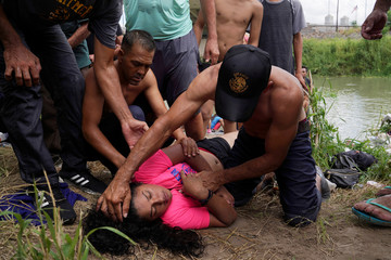 A Honduran girl named Breni, who is seeking asylum in the U.S., is resuscitated on the banks of the Rio Grande, where she had been bathing in Matamoros, Mexico