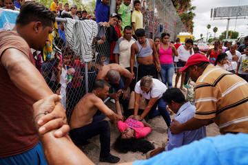 Breni, a Honduran girl who is seeking asylum in the U.S., is resuscitated near the Rio Grande, where she had been bathing in Matamoros, Mexico