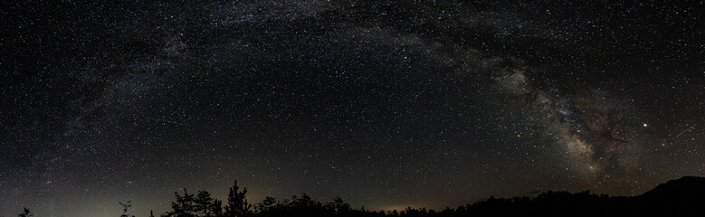 Panorama of night sky above lake Madh in National Park Lure, Albania Fotomurales