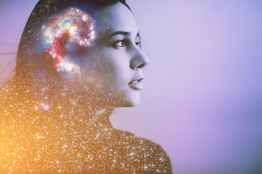 Double multiply exposure abstract portrait of a dreamy cute young woman face with galaxy universe space inside head. Human spirit, astronomy, life zen concept Elements of this image furnished by NASA.