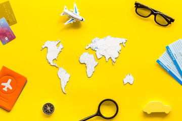 Planning a travel concept. Sketchy map of the world on yellow background top view