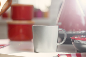 Cup of tea or coffee on modern kitchen background