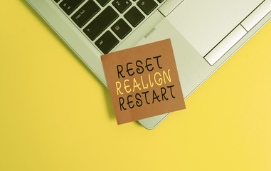 Writing note showing Reset Realign Restart. Business concept for Life audit will help you put things in perspectives Metallic trendy laptop blank sticky note empty text colored background