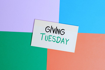 Text sign showing Giving Tuesday. Business photo text international day of charitable giving Hashtag activism Office appliance colorful square desk study supplies empty paper sticker
