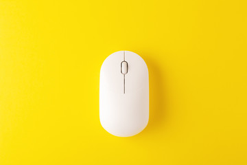 Wireless mouse on yellow background
