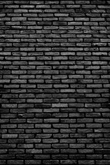 Surface of black brick stone wall textured for background