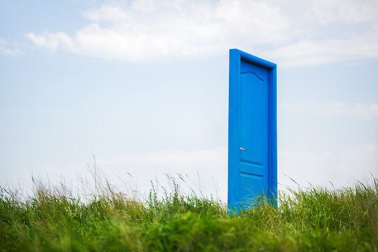blue, closed door in the field