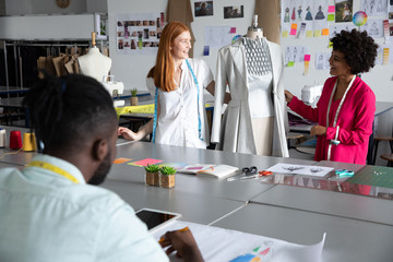 Young students working on projects at a fashion college