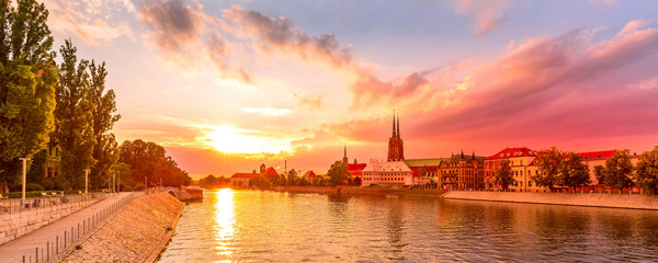 Deurstickers Koraal Wroclaw, Poland sunset panoramic banner with Ostrow Tumski island, Odra or Oder river and cathedral towers
