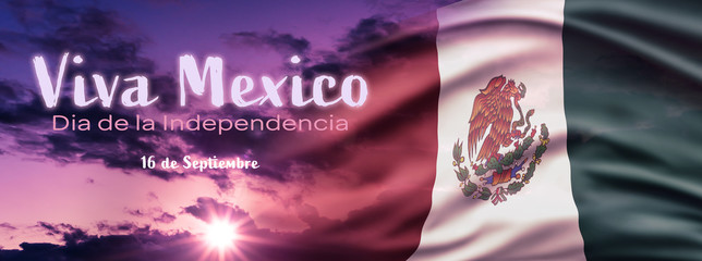Mexican National Holiday. Mexican Flag background with national colors. Cloudy blue hour sky. Spanish Text: Viva Mexico. Dia de la Independencia