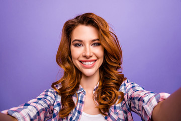 Photo of amazing foxy lady making selfies toothy smiling wear casual plaid shirt isolated purple color background