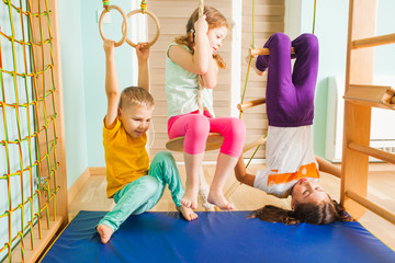 Children playing together in home kids gym