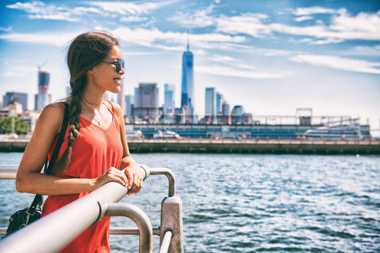 New York city woman tourist walking in summer vacation USA travel lifestyle. Tourism in the USA NYC skyline with One World Trade center in background.