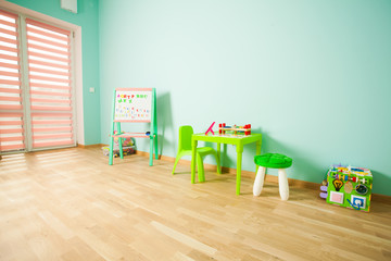 Education corner in the kindergaten with table and board