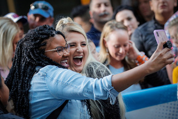 Singer Meghan Trainor poses for a selfie with a fan during an appearance on NBC's 'Today' show in New York