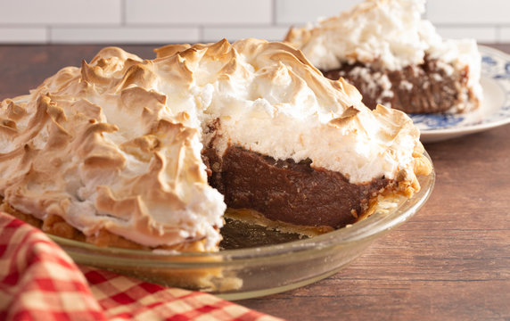 Chocolate Meringue Pie on a Rustic Wooden Table
