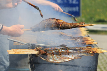 fish on a stick on the grill