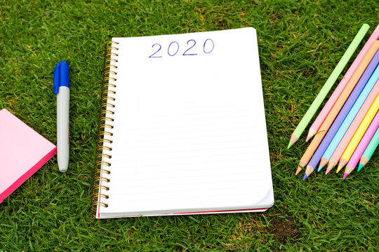 Empty notebook ready for New 2020 Year planing or wish list in the grass with