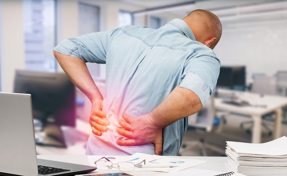 Man with back pain in office