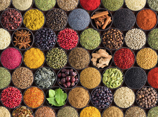 Fototapete - Fresh spices and herbs for food. Colorful condiments as background, top view. lot seasonings in cups, on table