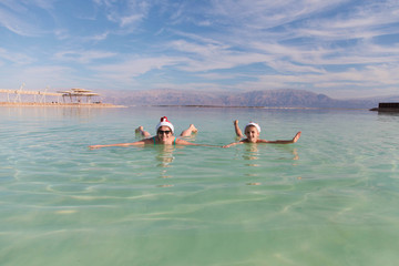 Chrismas family funny mood in dead sea