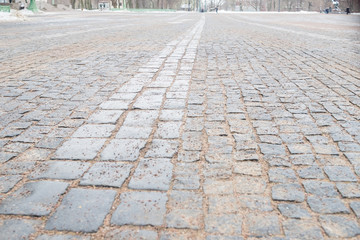 Cobblestone pavement.Vintage stone street road pavement texture.pattern of stone block paving.Selective focus.Granite cobble stoned pavement background. old cobblestone pavement Wall mural