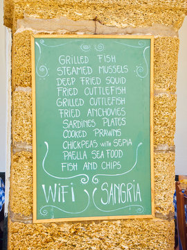 A blackboard offering typical Andalusian food. Cadiz. Andalusia, Spain.