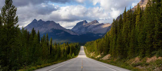 Wall Mural - Panoramic View of Scenic road in the Canadian Rockies during a vibrant sunny summer day. Taken in Icefields Parkway, Banff National Park, Alberta, Canada.