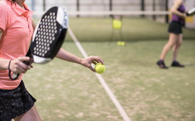 Padel tennis sports training. Women in court