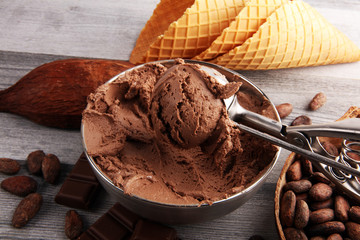 Chocolate coffee ice cream in a bowl on rustic white table