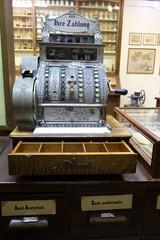 Swakopmund,Namibia.April 2019.A German made antique cash register inside a mock up display of an old chemist or pharmacy shop.Ihre Zahlung National Register circa 1900 model 422X.