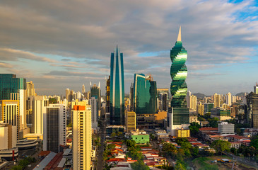 The colorful panoramic skyline of Panama City at sunset with high rise skyscrapers, Panama, Central America.